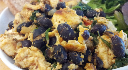Vegan tofu scramble with black beans and wilted spinach