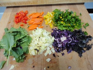 red bell pepper, carrot, chard, kale, green cabbage, red cabbage, purple kale