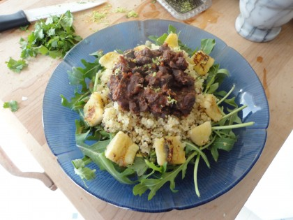 black beans in dried tomato chipotle in adobo paste, quinoa, seared banana, cilantro, arugula