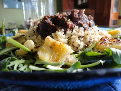black beans,  quinoa with mustard seeds, seared banana, arugula greens