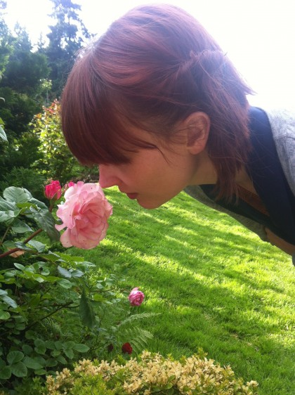 Kelly smelling the roses