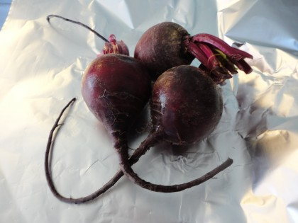 Beets ready to be wrapped in foil for slow cooker