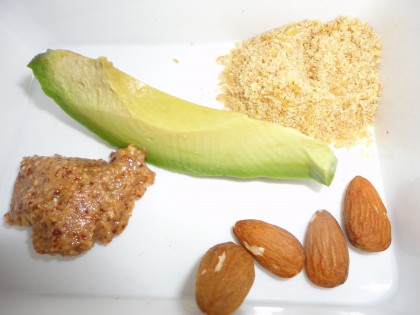 almond butter, avocado slice, ground golden flax seed, almonds