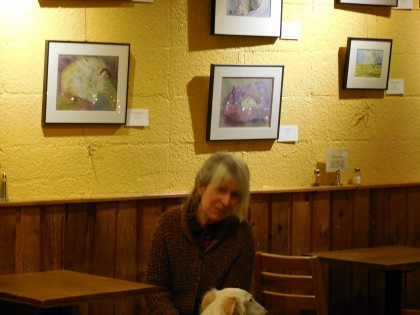 Maria Maggi and Romeo in front of her art show at Moscow Food-Co-op