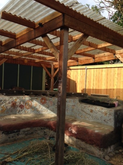 cob bench and roof