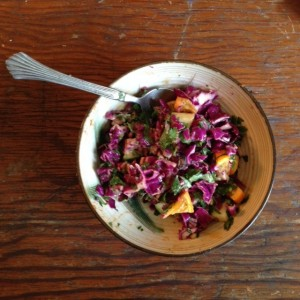 chopped salad with red cabbage, orange and cilantro