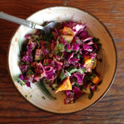 chopped salad with red cabbage, orange and cilantro up close